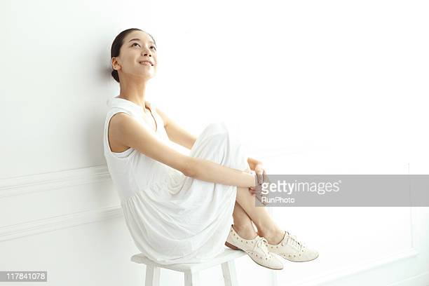 young woman sitting on a chair to relax