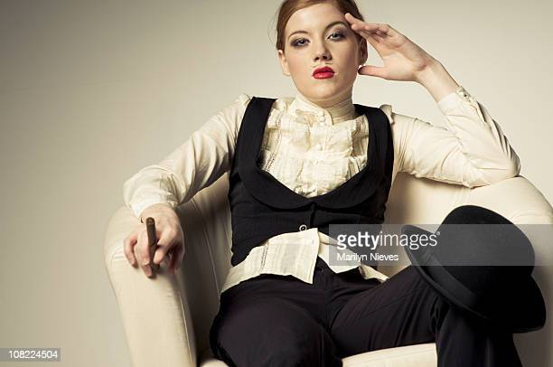 young woman sitting on chair - elizabethan collar stock photos and pictures