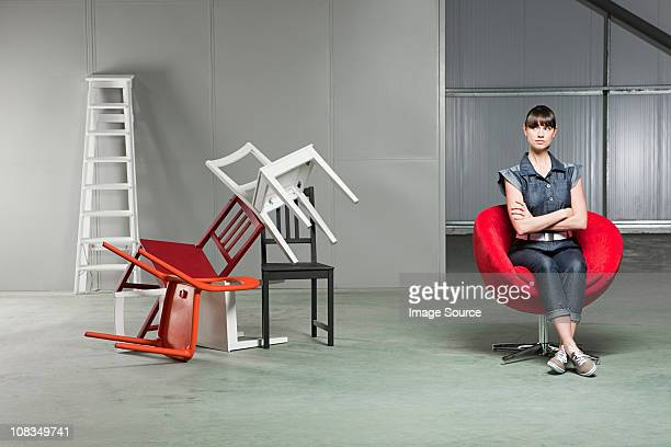 young woman sitting on red swivel chair - step ladder stock pictures, royalty-free photos & images
