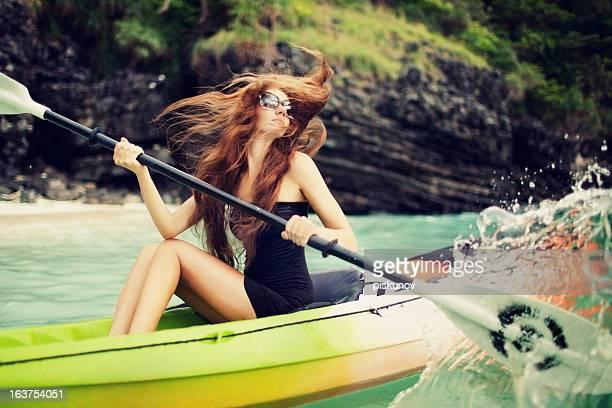 Young woman sitting on sea kayak