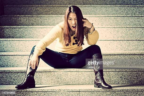 Young woman sitting on stair