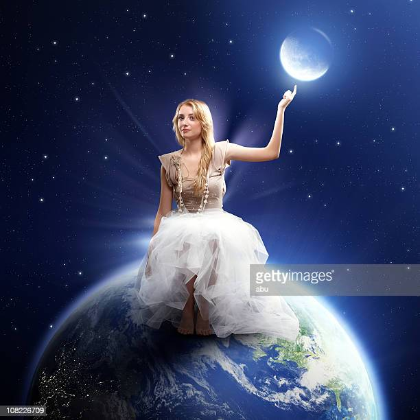 Young Woman Sitting on Top of Earth at Night