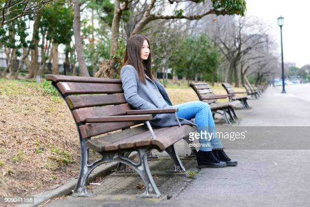 Young woman sitting outside