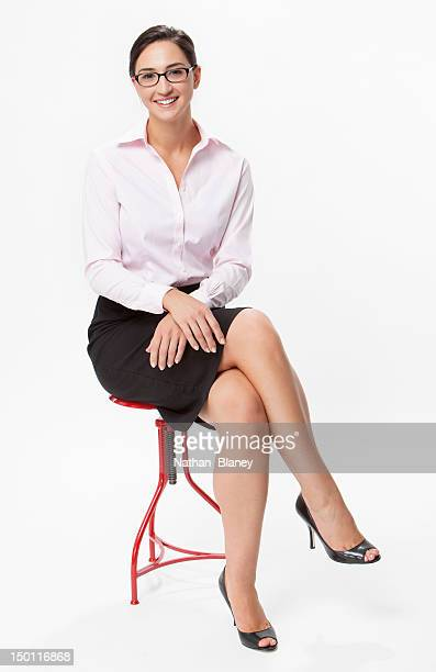 Young woman sitting with legs crossed