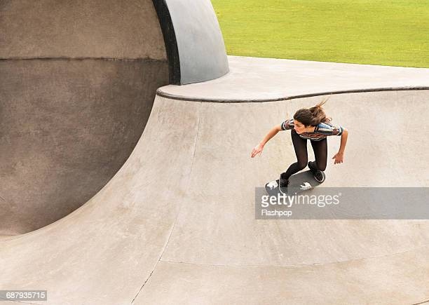 young woman skateboarding - skating stock pictures, royalty-free photos & images