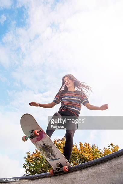 Young woman skateboarding
