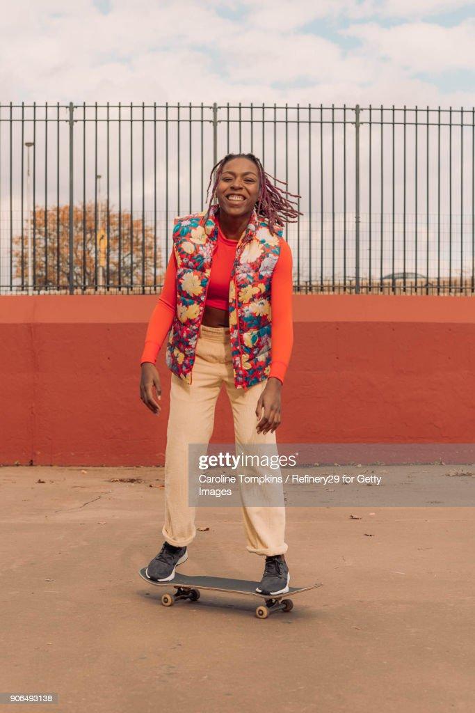Young Woman Skateboarding : Stock Photo