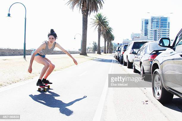 Young woman skateboarding, Port Melbourne, Melbourne, Australia