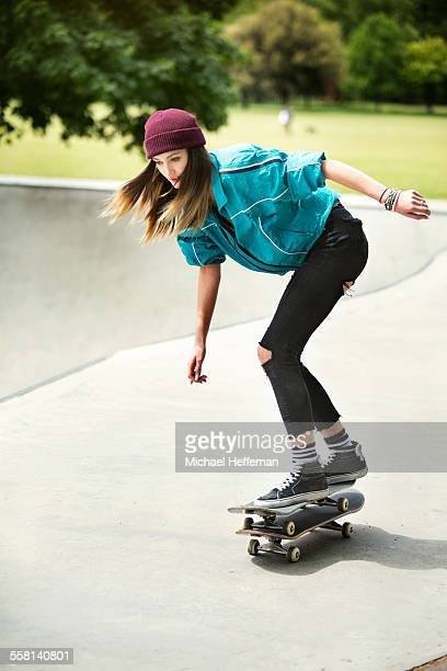 Young woman skates on two skateboards