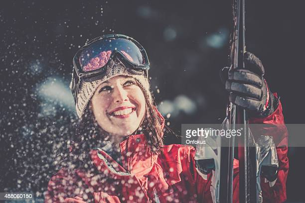 Young Woman Skier Smiling Holding Skis in Witer Time