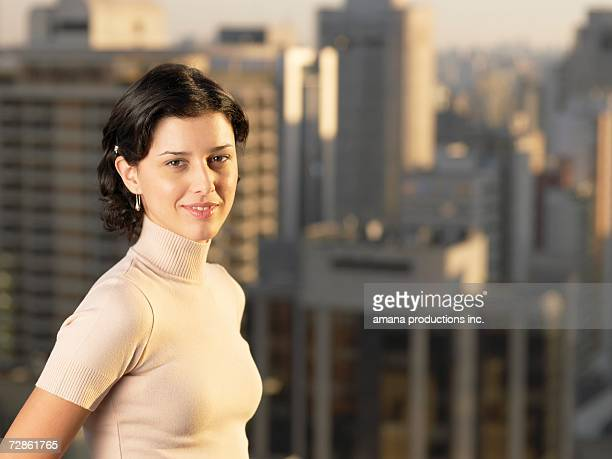 young woman, skyscrapers in background (portrait), sao paolo, brazil - high collar stock pictures, royalty-free photos & images