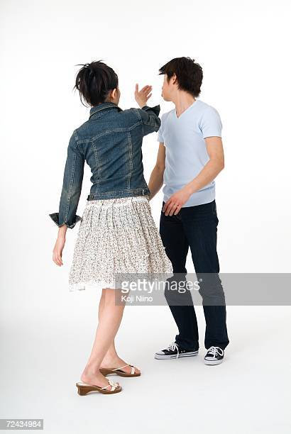 Young woman slapping her boyfriend