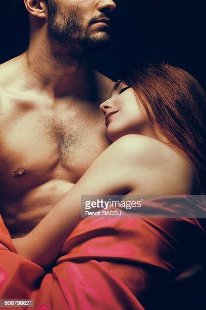 Young woman sleeping in her mans arms
