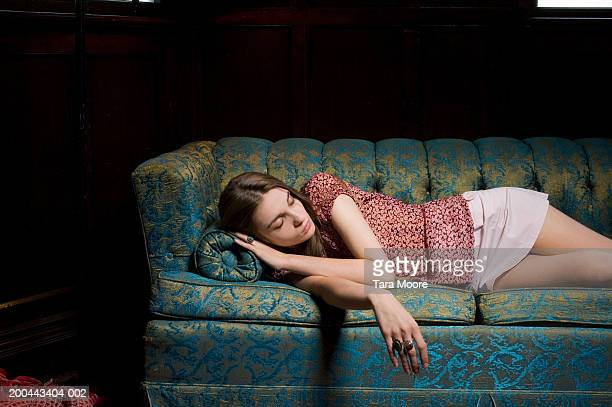 Young woman sleeping on sofa