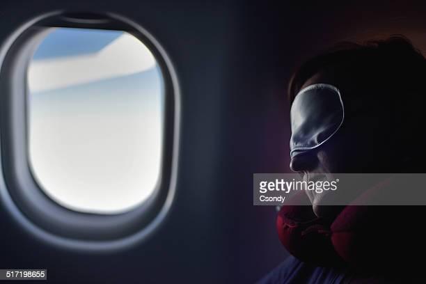 Young woman sleeping on the aircarft