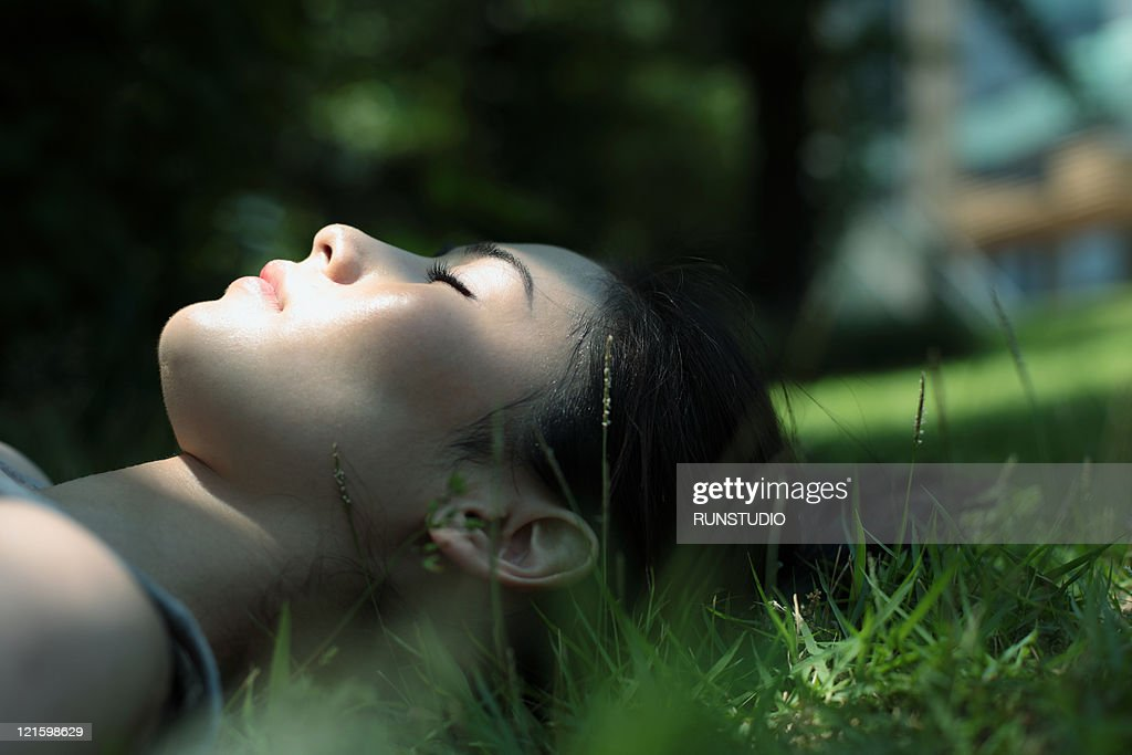 young woman sleeping on the grass : Stock Photo