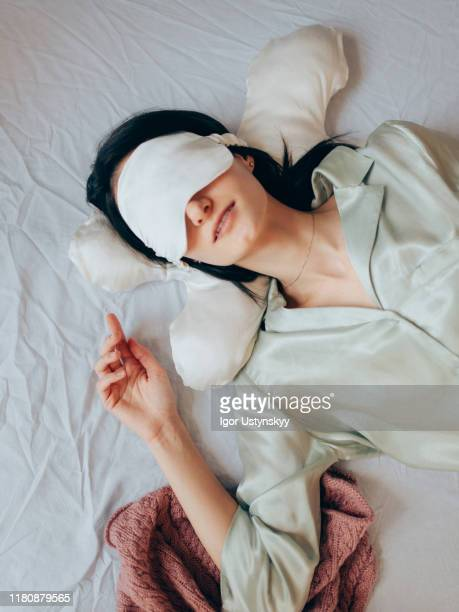 young woman sleeping with eye mask - silk stock pictures, royalty-free photos & images