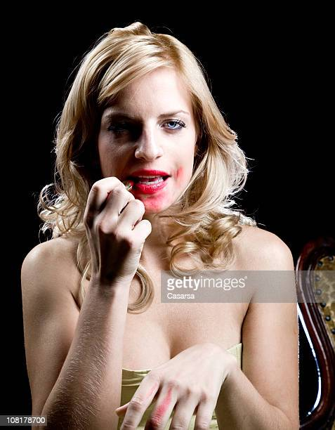 Young Woman Smearing Lipstick All Over Mouth