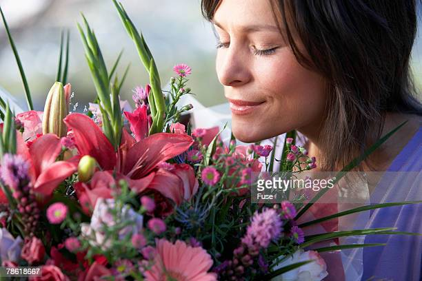 Young Woman Smelling Bouquet