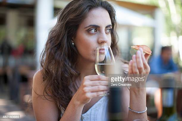 Young woman smelling wine at vineyard bar