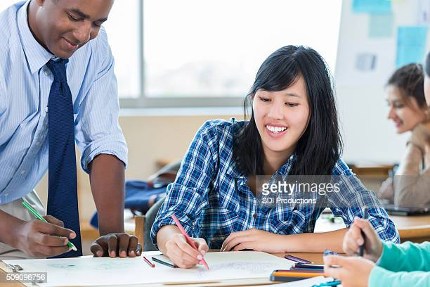 Young woman smiles as she works on design firm project