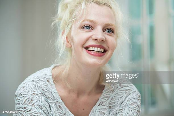 Young woman smiling and looking away