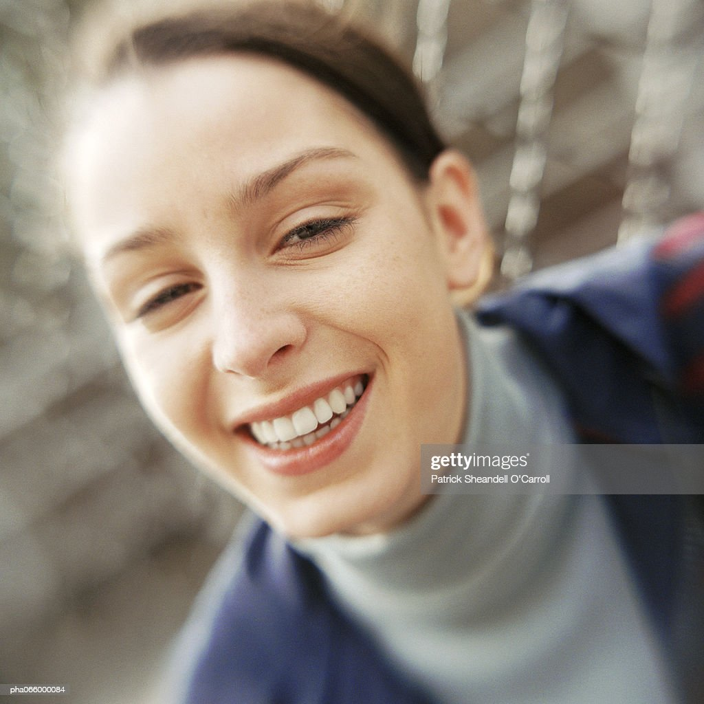 Young woman smiling at camera, close-up portrait. : Stock Photo