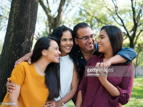 young woman smiling at her family - latin american culture stock pictures, royalty-free photos & images