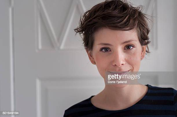 young woman smiling at the camera - short hair stock pictures, royalty-free photos & images