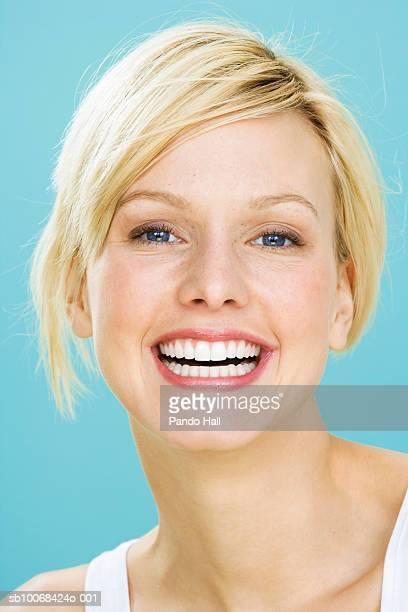 Young woman smiling, close up, studio shot