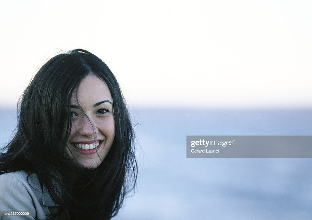 Young woman smiling, close-up. : Stockfoto