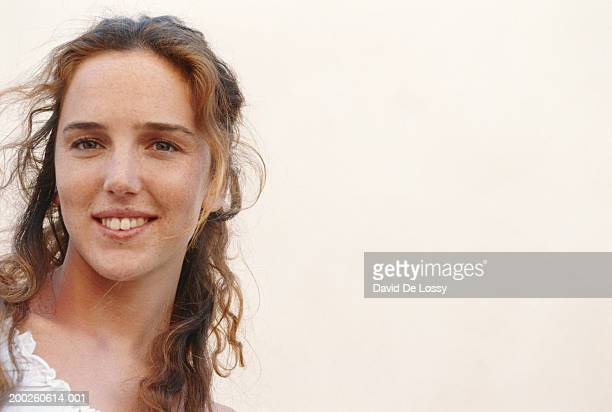 young woman smiling, close-up, portrait - one young woman only stock pictures, royalty-free photos & images