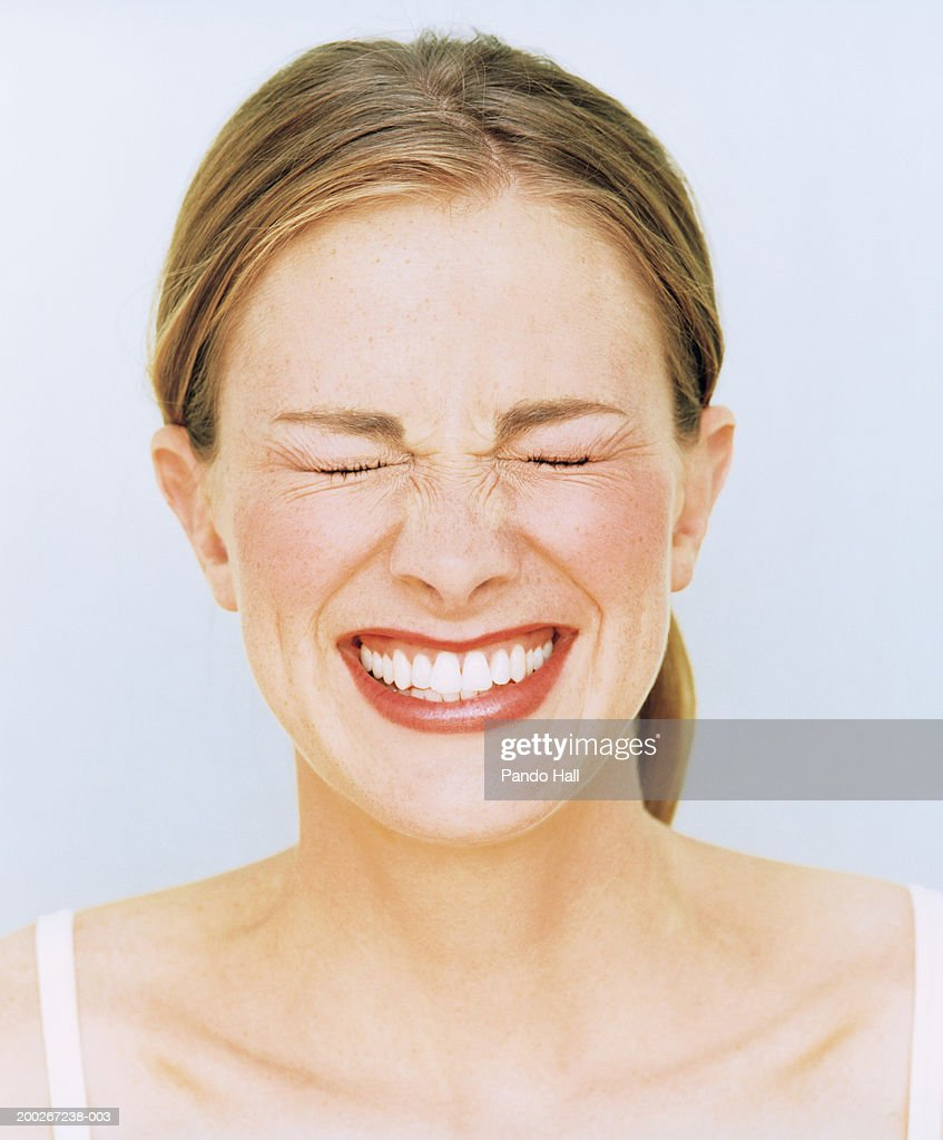Young Woman Smiling Eyes Closed Closeup Stock Photo