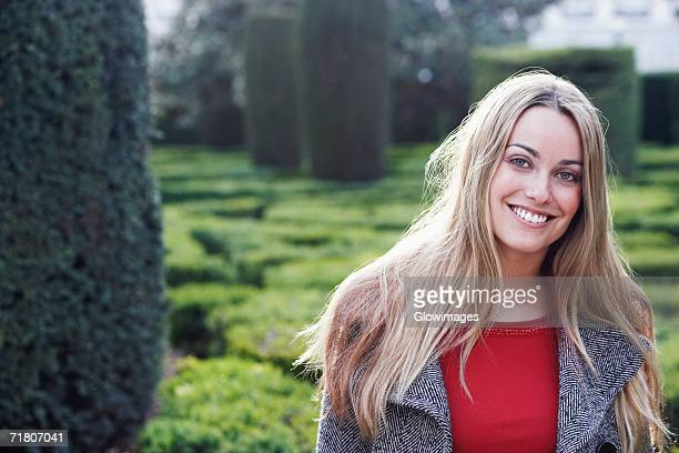 Young woman smiling in a garden