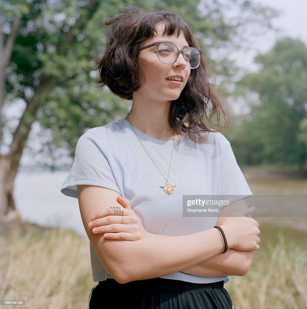 Young woman smiling in park : Stock Photo