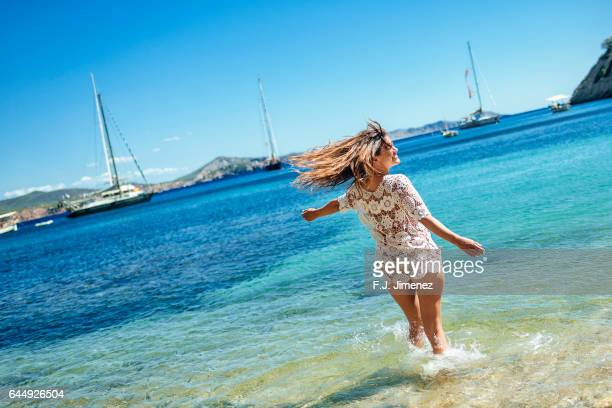 Young woman smiling in the water at Beach in Ibiza