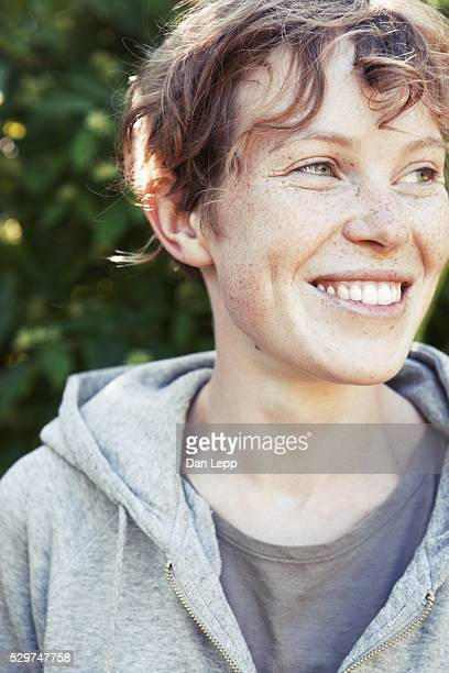 Young woman smiling, looking away