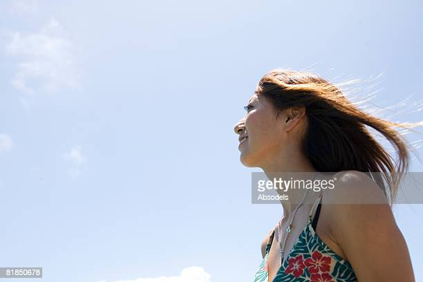 Young woman smiling, low angle view