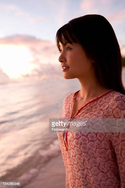 young woman smiling on beach in the evening, saipan, usa - saipan stock pictures, royalty-free photos & images