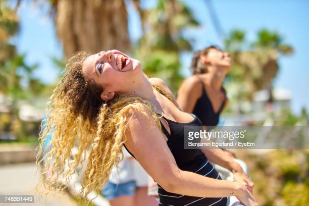 young woman smiling outdoors - head back stock pictures, royalty-free photos & images