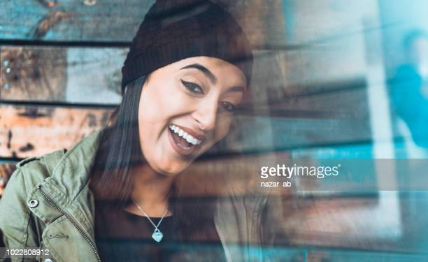 Young woman smiling.
