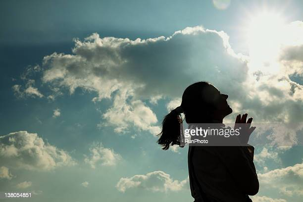 young woman smiling - praying stock pictures, royalty-free photos & images