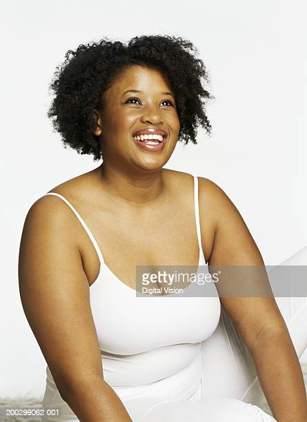 young woman smiling - images of fat black women stock photos and pictures