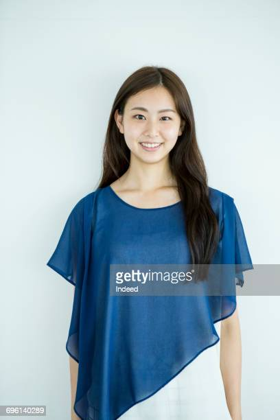 young woman smiling - 上半身 ストックフォトと画像