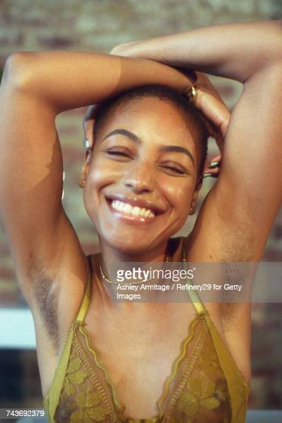 young woman smiling  - 67percentcollection stockfoto's en -beelden