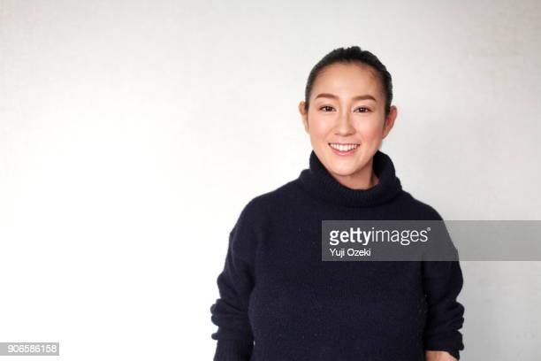 young woman smiling - turtleneck stock pictures, royalty-free photos & images
