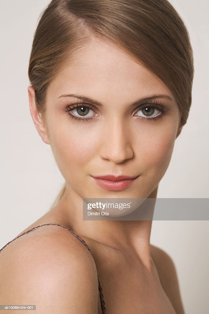 Young woman smiling, portrait, close-up : Stock Photo