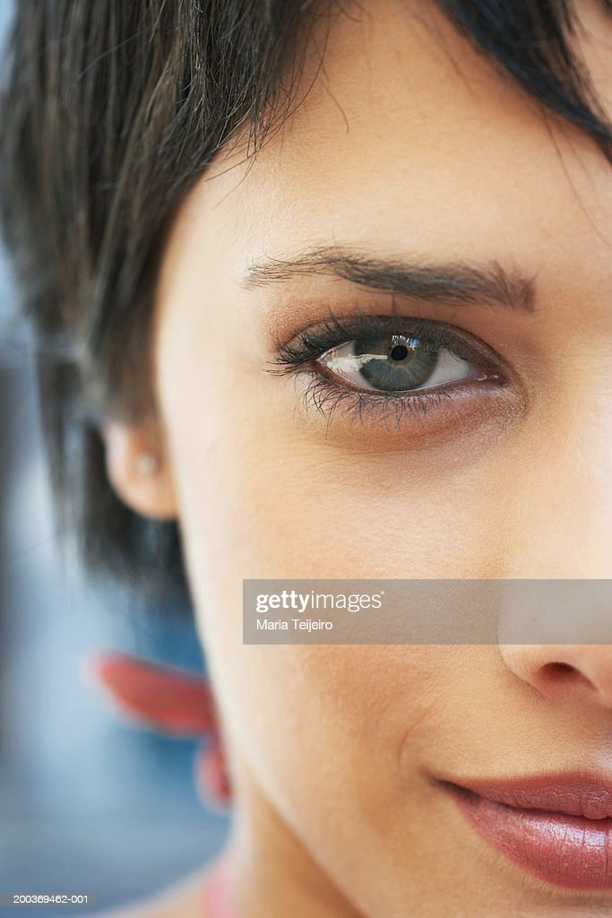Young woman smiling, portrait, high section, close-up : Stock Photo