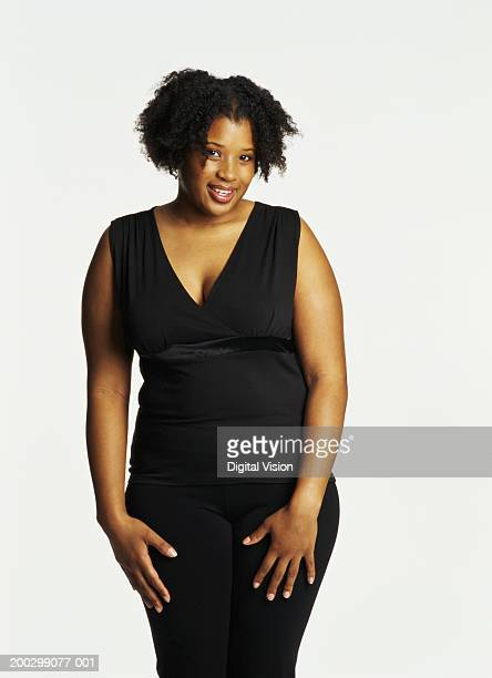 young woman smiling, portrait - images of fat black women stock photos and pictures
