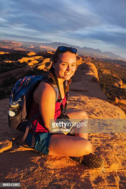 Young woman smiling relaxing in Arches National Park